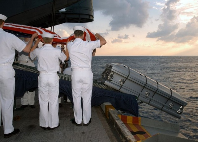 The casket bearing the body of US Navy Sailor during a Burial at Sea