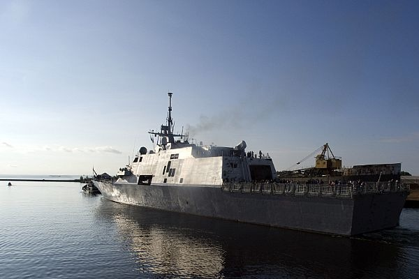 USS Freedom LCS-1 being led out by tug boat